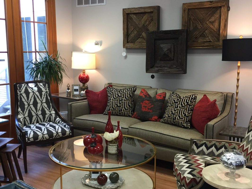 Inside the studio dreambridge design llc interior design and beige and black sofa with black leather contrast piping red beige and black accent pillows gilded bamboo floor lamp with black shade aloadofball Choice Image
